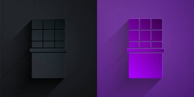 Paper cut Chocolate bar icon isolated on black on purple background. Paper art style. Vector. icon