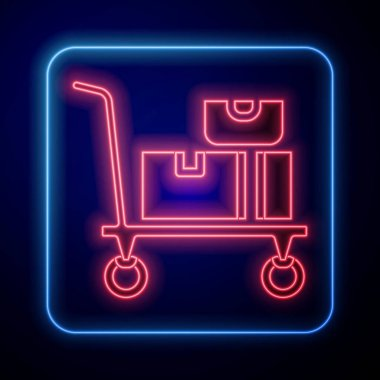 Glowing neon Hand truck and boxes icon isolated on black background. Dolly symbol.  Vector. icon
