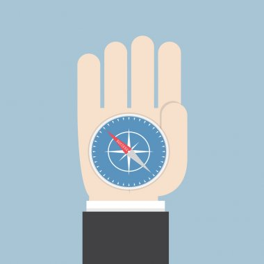 Businessman hand holding a compass that points to success