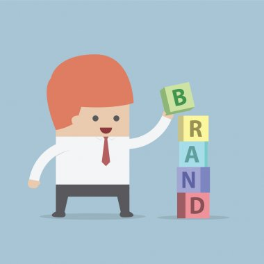 Businessman is building BRAND word, Brand building concept