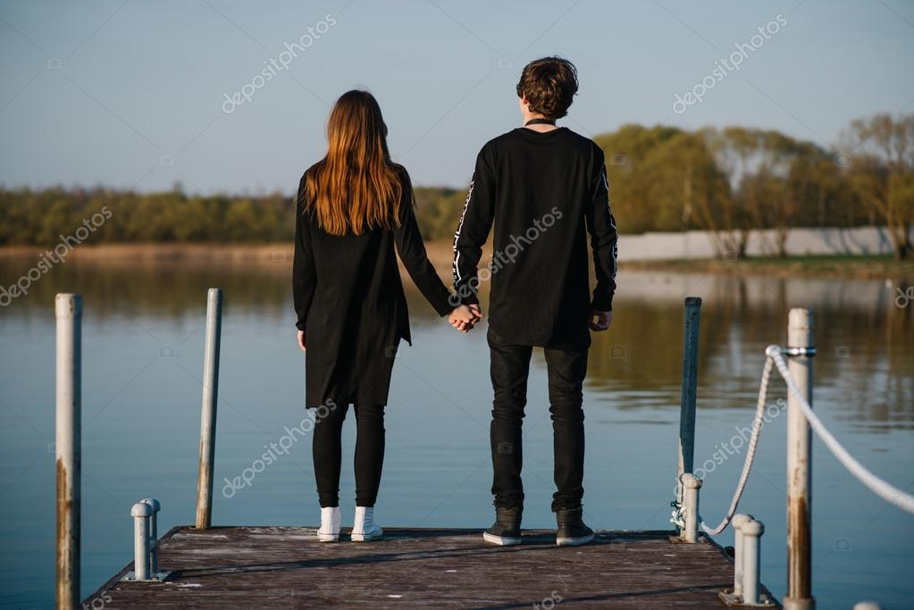 Couple Holding Hands Into The Distance