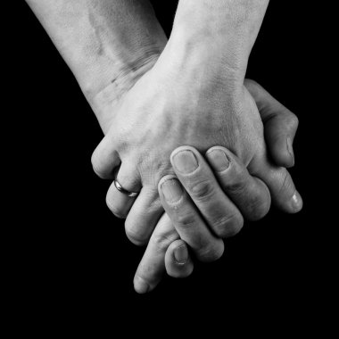 Male and female holding hands