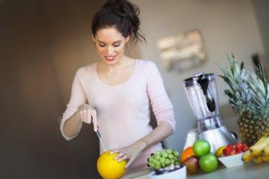 Woman Cutting Melon
