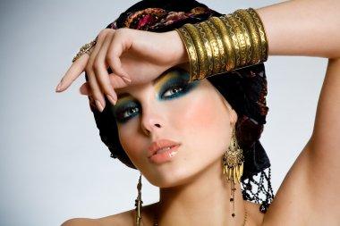Beautiful oriental looking woman. stock vector
