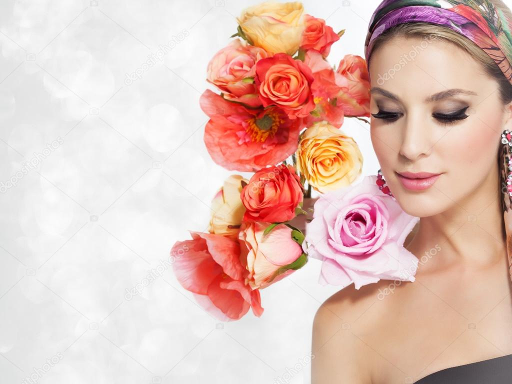Beautiful woman with flowers stock photo iconogenic 94931164 beautiful woman portrait with glamour makeup and background decorated with artificial colorful flowers photo by iconogenic izmirmasajfo Image collections