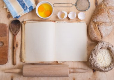 Baking background with blank cook book, eggshell, flour, rolling