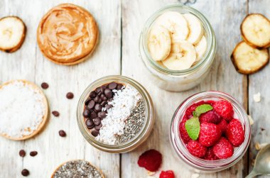set overnight oats with berries, coconut, peanut butter, Chia se