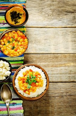 rice with curry chickpeas with vegetables and Arabic flat bread