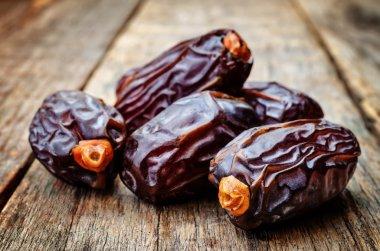 medjool dates on a dark wood background