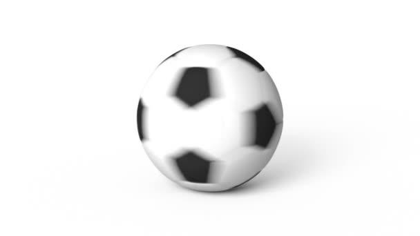Fotbalový míč otáčí na bílém bg