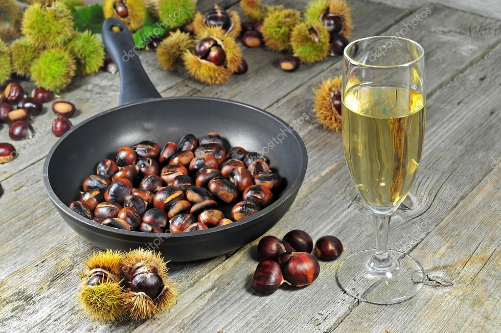 Roasted chestnuts with glass of white wine