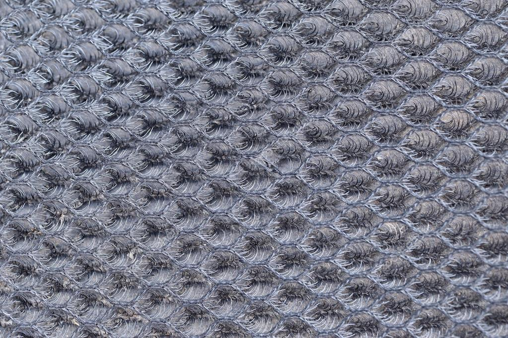 Abstract background of knitted wire mesh. — Stock Photo © enrouteksm ...