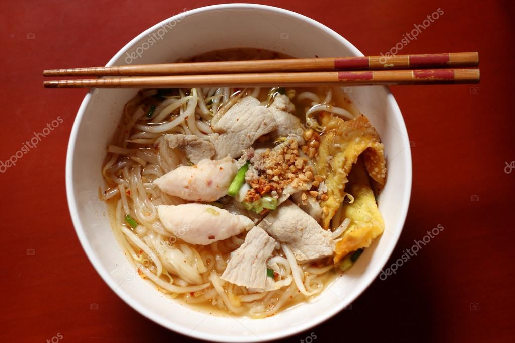 Asian rice noodle soup with pork, fish ball and crisps dumpling.