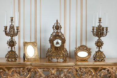 Antique clock with candlesticks.