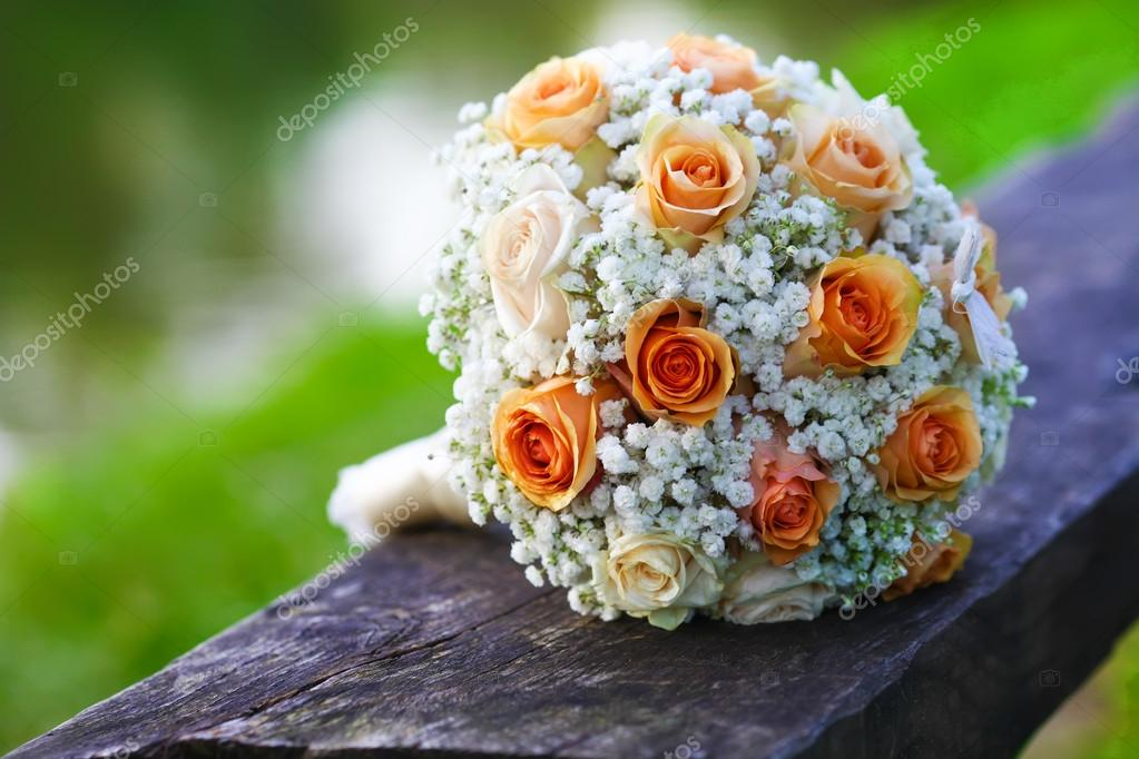 Wedding Bridal Bouquet Of Orange Roses Lying On Wooden Floor Stock