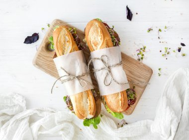 Sandwiches with beef, fresh vegetables and herbs