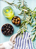 Fotografie Two bowls with pickled green and black olives