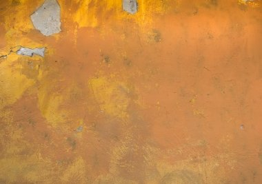 Old rustic yellow painted stone texture