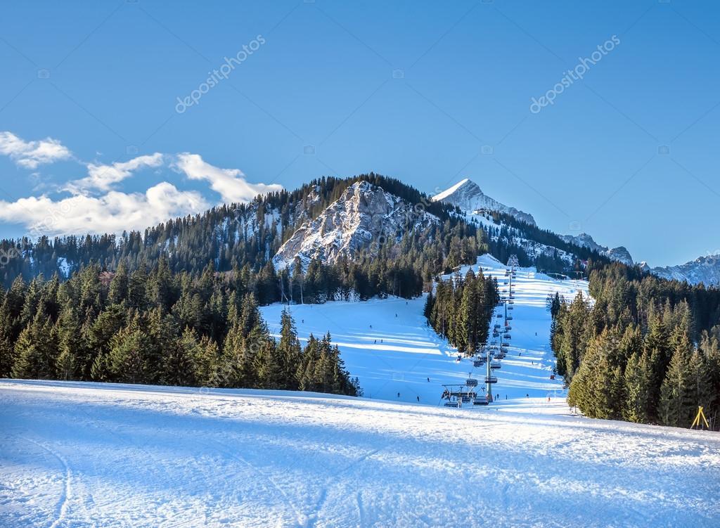 Mountain skiing slopes and ski lift at Hausberg top near Garmisc