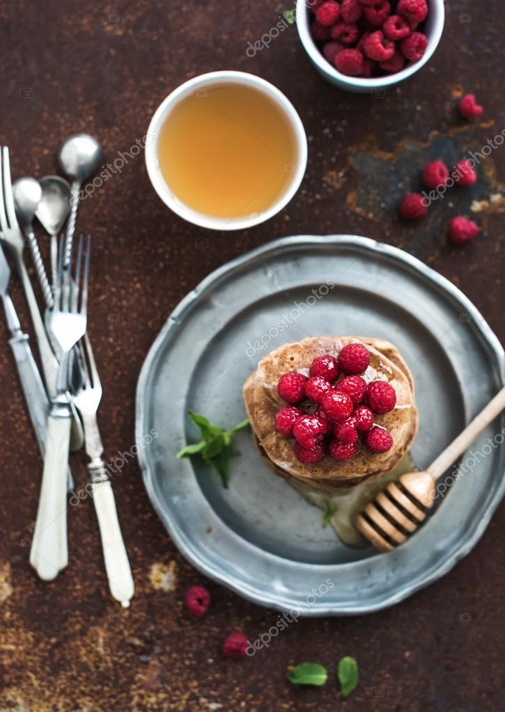 Buckwheat Pancakes With Fresh Raspberries, Honey And Mint Leaves Over  Grunge Metal Background, Top View, Selective Focus U2014 Foto Von Sonyakamoz