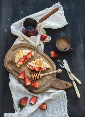 Freshly baked croissants with strawberries