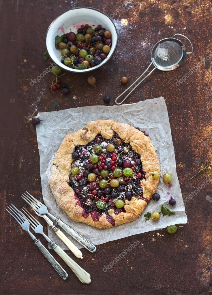 Summer crostata or galette pie with fresh garden berries and van