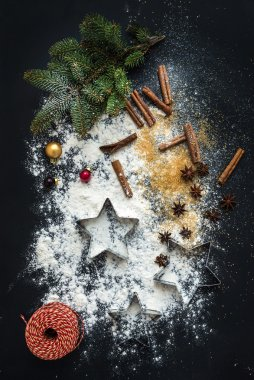 Baking ingredients for Christmas holiday traditional gingerbread cookies preparation, black background