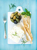 Fotografie Fresh feta cheese with olives