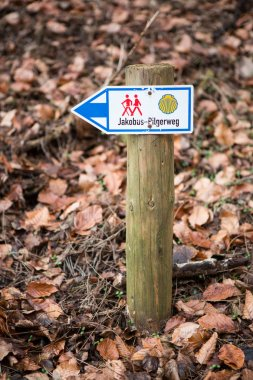 Waymarking on the Camino de Santiago, long distance pilgrimage, Europe, mountains intentionally out of focus