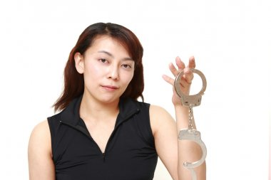 woman with unlocked handcuffs