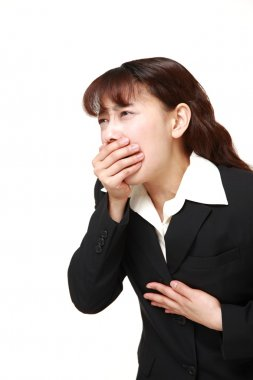 Asian businesswoman feels like vomiting