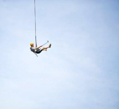Bungee jumper shoots self in flight