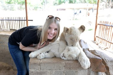 The girl and white Lion cub, South Africa.