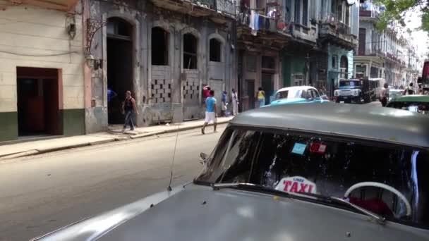 Classic blue car driving through in Havana, Cuba