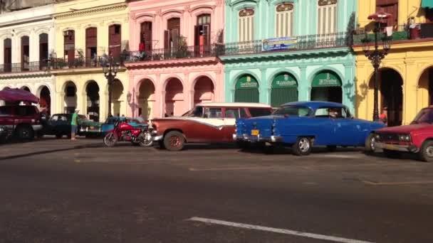 Classic cars and colourful houses downtown Havana, Cuba