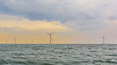 Offshore wind farm in setting sun