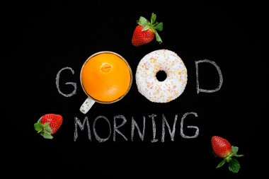 Good morning greeting on chalk board. Healthy food, fresh fruits and donut