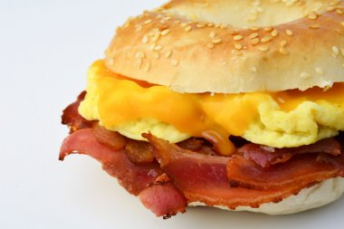 Bagel with bacon, cheese and scrambled eggs, isolated