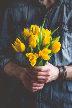 Boquet of yellow tulips in hands
