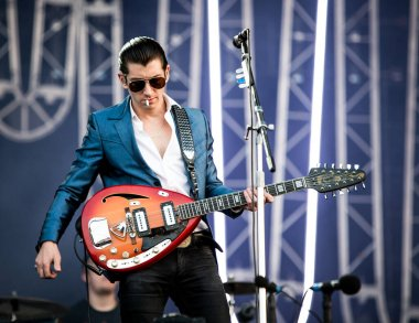 Arctic Monkeys performing on stage during  music festival