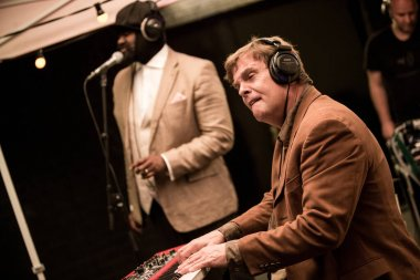 Gregory Porter performing on stage during  music concert