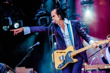 Nick Cave and the Bad Seeds performing on stage during  music concert