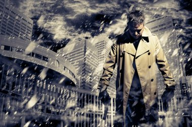 Killer standing on dark city background to kill