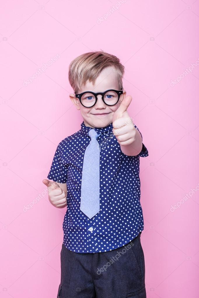 699809c6194 Portrait of a little smiling boy in a funny glasses and tie. School.  Preschool. Fashion. Studio portrait over pink background — Photo by ...