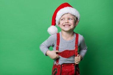 Beautiful little boy dressed like Christmas elf with big smile. Christmas concept