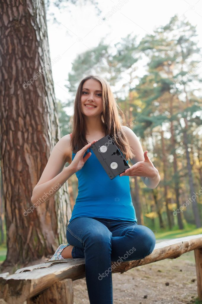Girl with a cassette in her hands