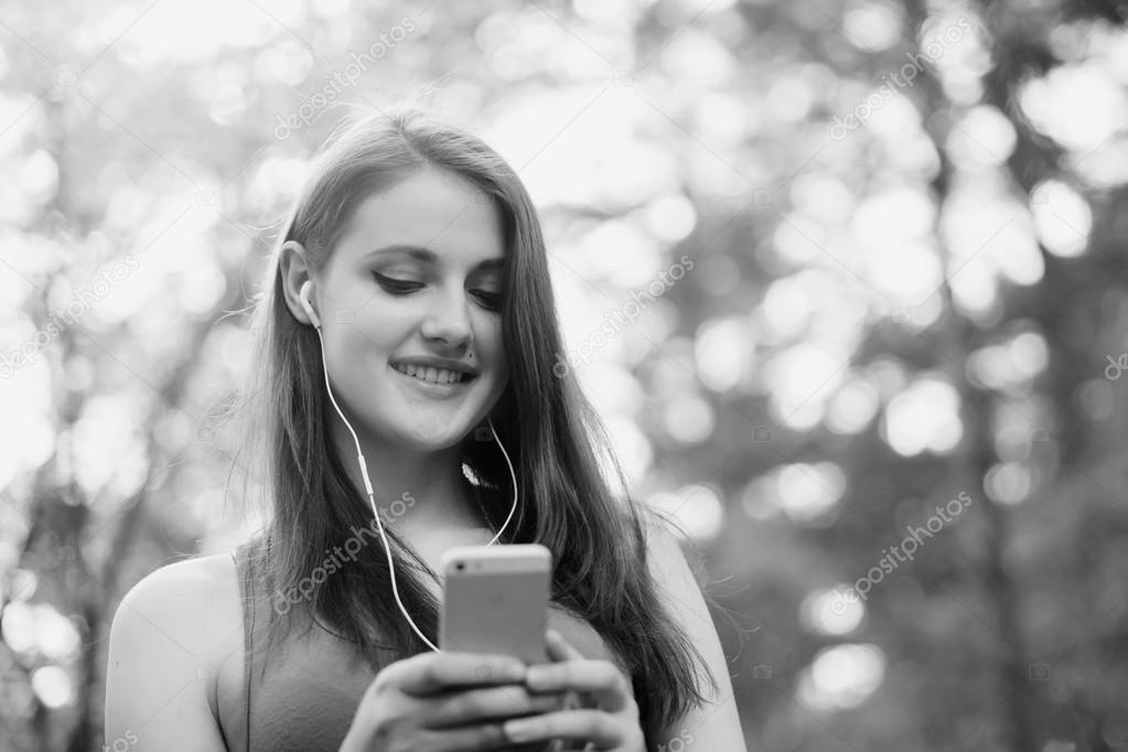 Beautiful girl talking with smartphone