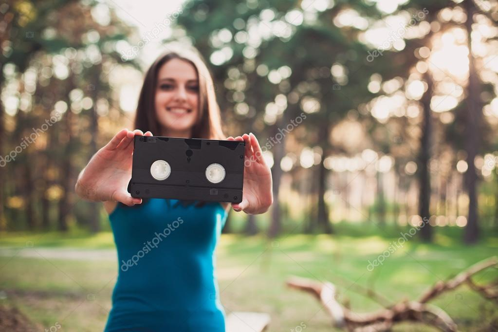 Girl with a VHS cassette in her hands
