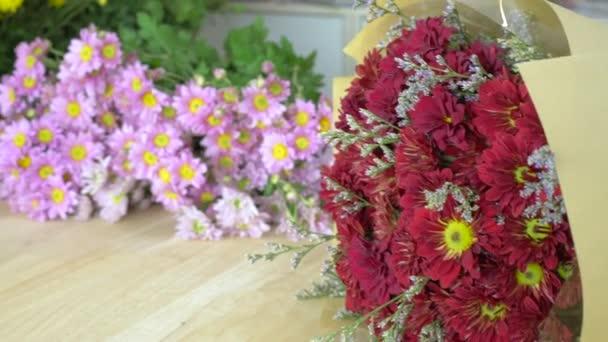 Flower shop, various beautiful flower, red mums bouquet, various color mums, roses, lilies, etc.