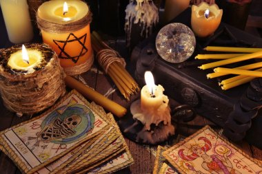 Tarot cards, candles, crystal